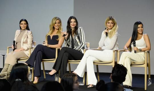 The Kardashians/Jenners discussing the launch of their new apps at an Apple Store. (Photo: Getty Images)